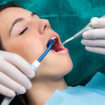 Woman having dental cleaning.